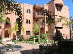 Piso en venta en Ennakhil (Palmeraie). Area 103.0 m². Plazas de parking y bonito jardín.
