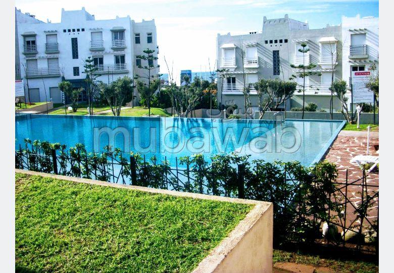 Location d'un appartement rez de jardin face à la piscine à Dar Bouazza. 2 chambres Meublé