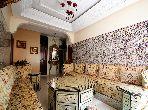 شقة للبيع بدار بوعزة. المساحة الإجمالية 129.0 م². صالة مغربية وصحن فضائي.