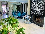 بيع شقة ببوسكورة. المساحة الإجمالية 147 م². حديقة وشرفة.