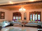 Fabulous villa for sale. Dimension 558 m². Living room with Moroccan decor, General satellite dish system.