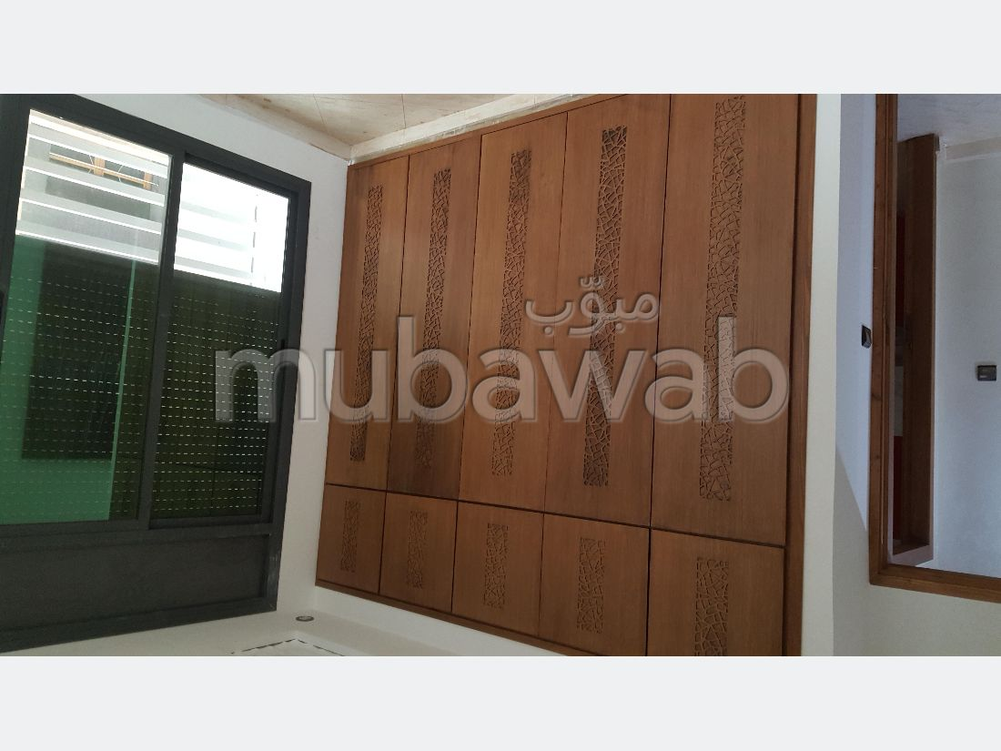 Find an apartment to buy. Dimension 80.0 m². Traditional Moroccan living room.