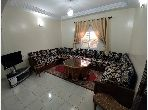 Apartment to purchase in Cité Adrar. Area of 65.0 m². Traditional Moroccan living room, secured residence.