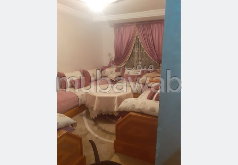 Beautiful apartment for sale in Les Portes de Marrakech. 3 Rooms. Living room with European decor.
