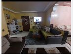 Beautiful apartment for sale in Centre. Surface area 136.0 m². Moroccan living room and satellite dish.