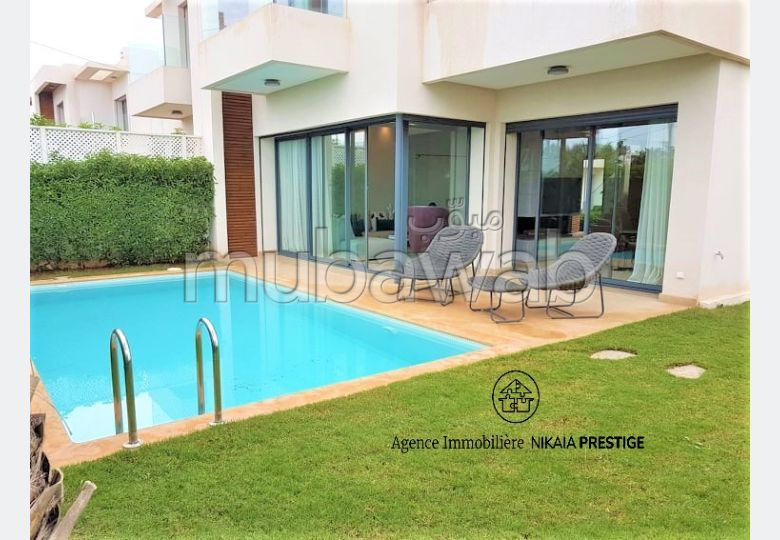 House for sale in Ain Diab. Total area 328 m². caretaker service available, General air conditioning.