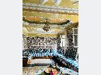 House for sale in Derb Moulay Cherif. 5 Hall. Traditional living room and satellite dish system.