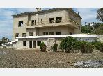 Luxury villa for sale in Achakar. Area 2104 m². Parking spaces and garden.
