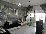 Bel appartement à vendre à El Kantaoui. Superficie 80 m². Porte sécurisée et chauffage central