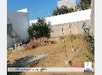 Terrain clôturé avec permis de bâtir, à Kharouba